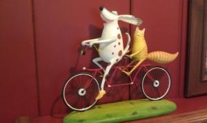 cat and dog on bike